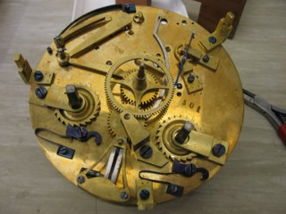 Guilmet Mystery Clock internal workings under dial