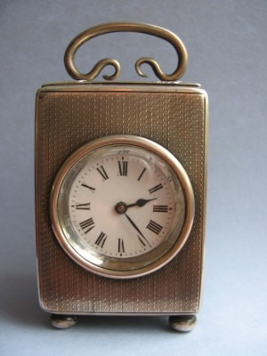 small silver-cased carriage clock